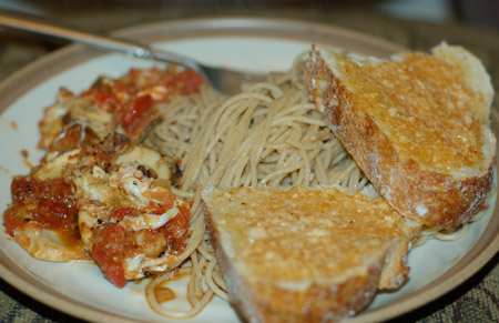 Porcini parmesan with spaghetti and garlic bread