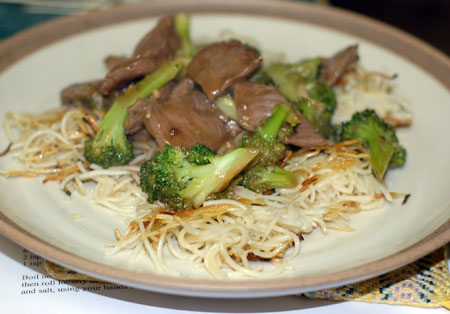 Beef and broccoli with noodle pancake