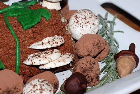 Decorated buche with shelf mushrooms